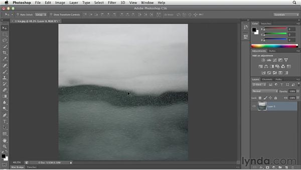 Bringing back hidden pixels with Reveal All: Photoshop CS6 Essential Training