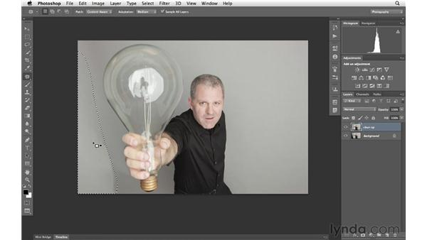 Cleaning up a backdrop with the Patch tool: Photoshop for Photographers: Portrait Retouching