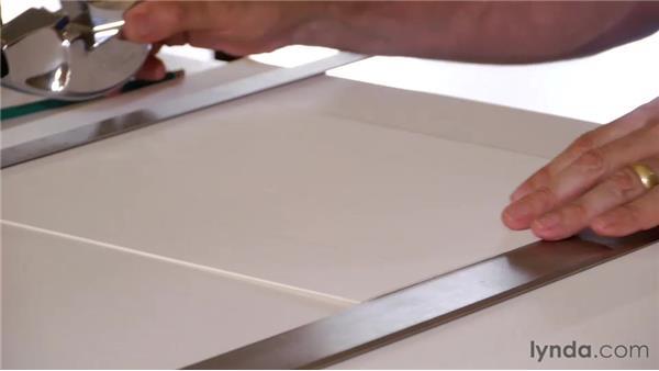 Using a handheld mat cutter