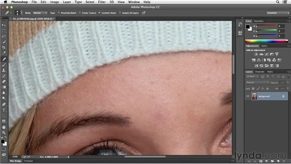 Removing blemishes with the Healing Brush and Patch tools: Photoshop CC Essential Training (2013)