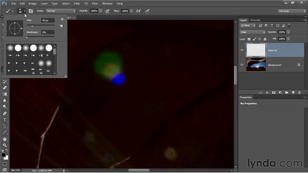 Removing color from a lens flare: Up and Running with Color Correction in Photoshop CC
