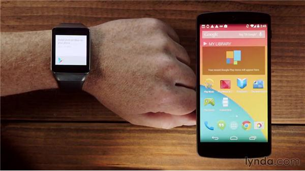 Setting up the watch and pairing it with a phone: Up and Running with Android Wear