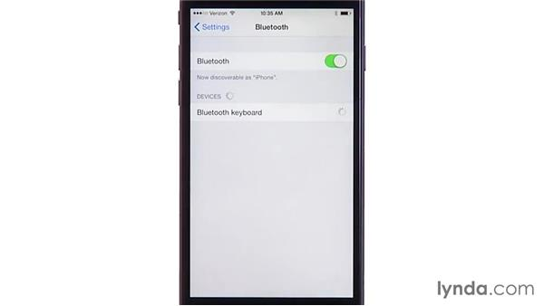 Syncing a Bluetooth keyboard: iOS 8: iPhone and iPad Essential Training