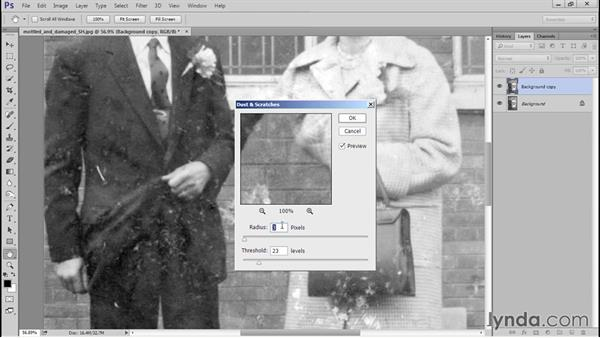 Removing initial dust and scratches with the Dust and Scratches filter: Photo Restoration Techniques: Damaged Black-and-White Images
