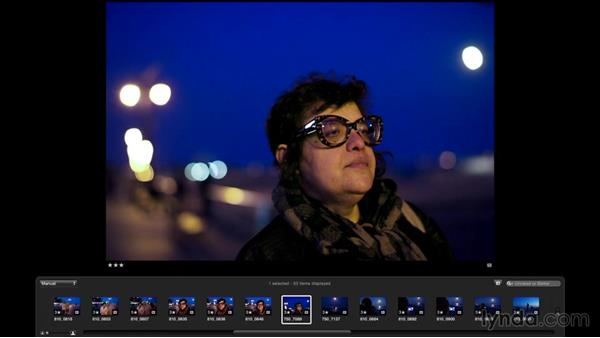 Reviewing the shots from the beach boardwalk: Street Photography: The City at Night