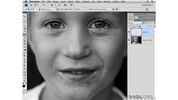 Cleaning up small facial details: Photoshop CS4 Portrait Retouching Essential Training
