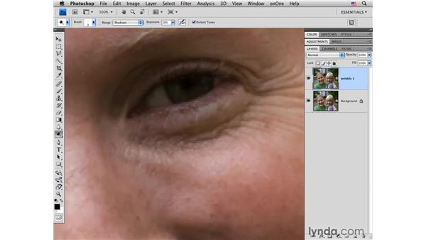 Using the Dodge tool and blending modes on wrinkles: Photoshop CS4 Portrait Retouching Essential Training