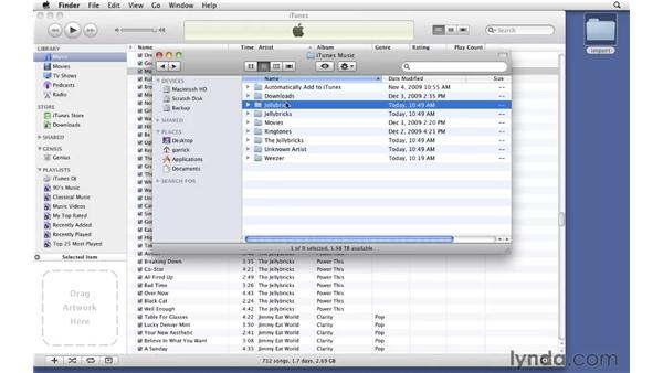 Dragging in song files: iTunes 9 Essential Training