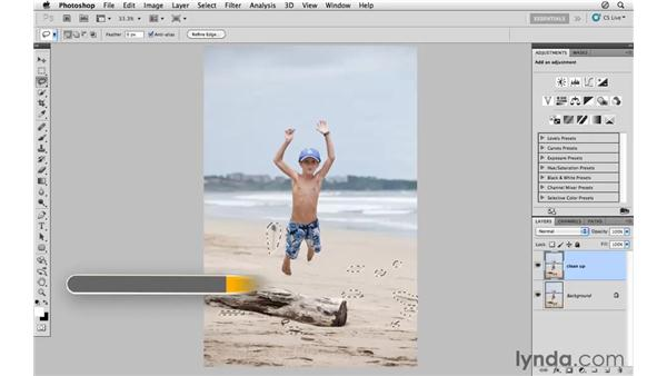Cleaning up the image with Content-Aware Fill: Photoshop CS5: Athletic Retouching Projects